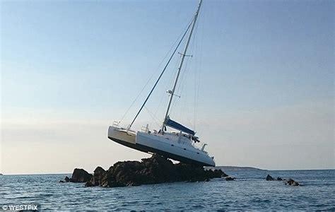 Catamaran Sailing Ship by Catamaran Stranded On A Reef In Kimberley Region Wa