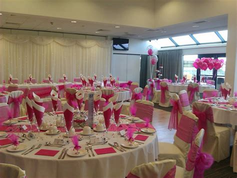 reception table settings on chair covers overlays and table numbers