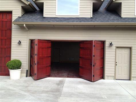 Bi Fold Garage Door  Nonwarping Patented Wooden Pivot