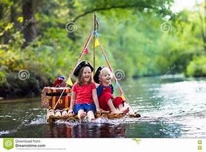 Kids Playing Pirate Adventure On Wooden Raft Stock Photo ...