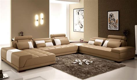 the interior of a living room in brown color features