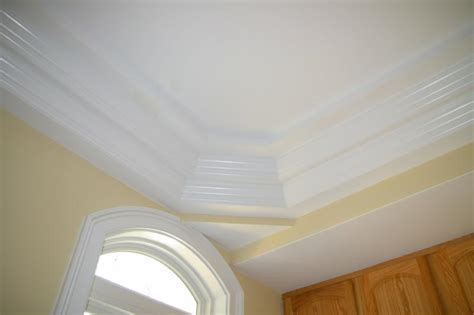 need help on crown molding on trey ceiling finish