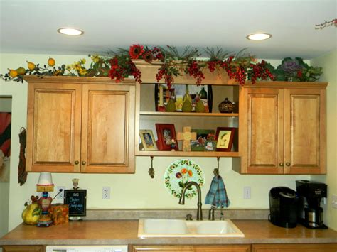 Above Kitchen Cabinet Decorations Pictures by Decorating Above Kitchen Cabinets Before And After