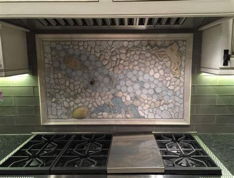 a large backsplash mural in quite the unique kitchen