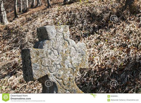 tombstone christian cross closeup stock image