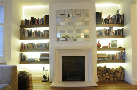 exposed brick wall surround fireplace wit white mantel also white wooden cabinet shelves beside