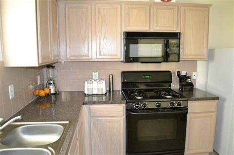 kitchen with oak cabinets with black appliances 715 quion ct crosby 77532 4102 home value