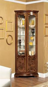 Corner showcase with two semi-circular doors in a classic ...