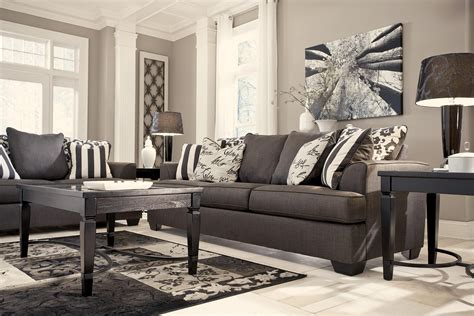 signature design by levon charcoal sofa with scatterback pillows and plush coil seat