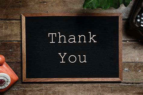 Thank You Text On Black And Brown Board · Free Stock Photo