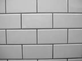 white subway tile grey grout