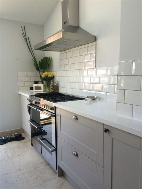 Grey Burford Kitchen With White Corian Worktops And Subway