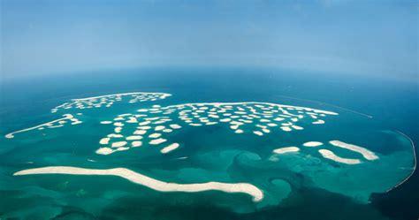dubai s world of islands is sinking into the sea the world islands in dubai inhabitat green