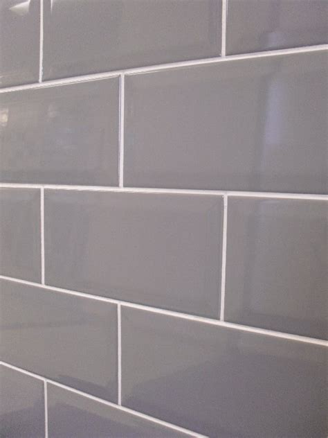 grey subway tile with white grout for stainless