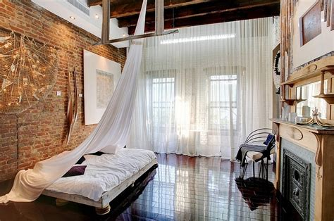 industrial loft style bedroom design with high ceiling and