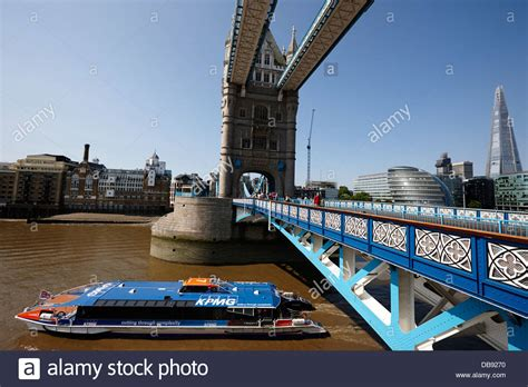 Boat Going Under Tower Bridge by London Thames Clipper Stock Photos London Thames Clipper