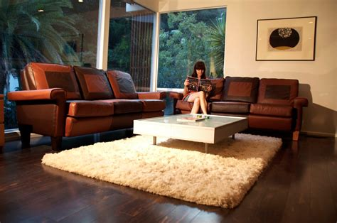 brown leather sectional living room ideas white fur rug with glass top living room table and