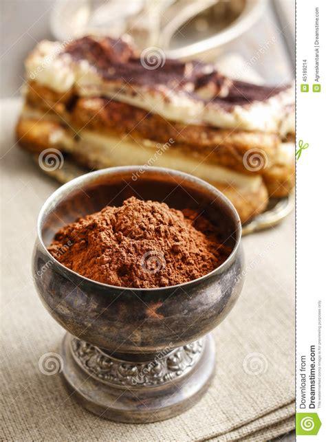 silver goblet of cocoa powder tiramisu cake in the background stock photo image 45189214